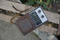 Old transistor radio for music lovers. The old transistor radio receiver of Soviet times, 80-ies. Old school is a thing for music lovers Royalty Free Stock Images