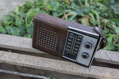 Old transistor radio for music lovers. The old transistor radio receiver of Soviet times, 80-ies. Old school is a thing for music lovers Stock Image