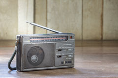 Old transistor radio on wood background. Royalty Free Stock Images