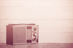Old transistor radio on wooden background. Royalty Free Stock Photos