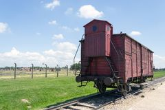 Old transport train wagon, Auschwitz-Birkenau Concentration Camp. Historic, original train wagon used to transport nazi victims into the Auschwitz-Birkenau II stock image