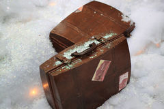 Old Suitcases. Two old brown suitcases on artificial snow Stock Photography