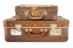 Old travel suitcases. Vintage old travel suitcases isolated on white background Stock Photos