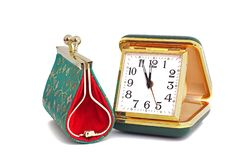 Old traveling clock and women`s wallet. Coin purse. Embroidered patterns. stock photography