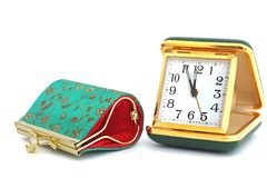Old traveling clock and women`s wallet. Coin purse. Embroidered patterns. stock image