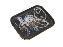 An old  tray with beads and jewelry. Stock Image