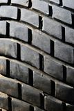 Old tread pattern for vehicle. Car wheel abrasion reduces safety. Close up stock image