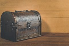 Old treasure box on wooden background antique royalty free stock photos
