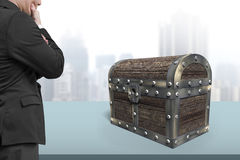 Old treasure chest with man looking at Royalty Free Stock Photography