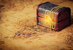 Old Treasure chest with shinny gold. Royalty Free Stock Images