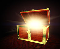 Old treasure chest. Old wooden treasure chest with strong glow from inside stock illustration