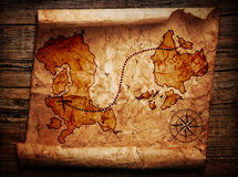 Old treasure map. On wooden background Royalty Free Stock Photos