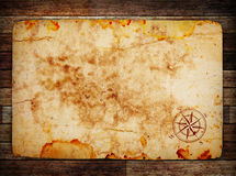 Old treasure map. On wooden background wih compass Stock Photography