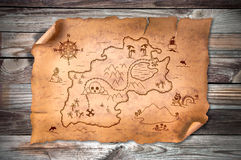Old treasure map. On wooden grunge background Royalty Free Stock Image