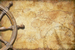Old treasure map with steering wheel. Aged treasure map with steering wheel Stock Images