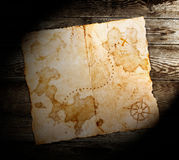Old treasure map. On wooden background Stock Images