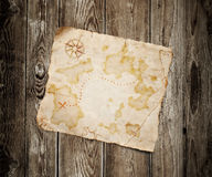 Old treasure map. On wooden background Royalty Free Stock Image