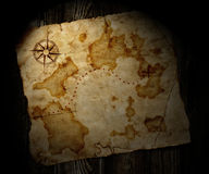 Old treasure map. On wooden background Royalty Free Stock Images