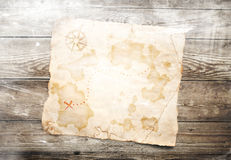 Old treasure map. On wooden background Stock Photo