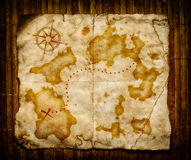 Old treasure map. On wooden grunge background Stock Image