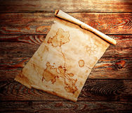 Old treasure map. On a wooden grunge background Stock Photos