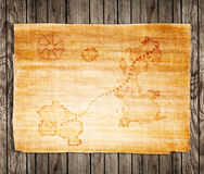 Old treasure map. On a wooden grunge background Royalty Free Stock Photos