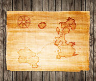 Old treasure map. On a wooden grunge background Royalty Free Stock Photo