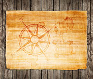 Old treasure map. On a wooden grunge background Stock Images