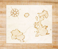 Old treasure map. On a wooden grunge background Stock Photography