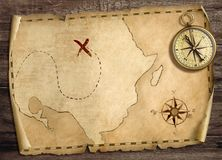 Old treasure pirates` map with compass on wood table. 3d illustration. Old treasure pirates` map with compass on wood table top view Stock Photos