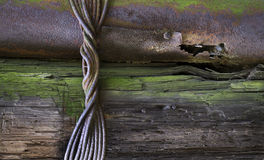 Old tree and rusty pipe. Grunge background Royalty Free Stock Photos