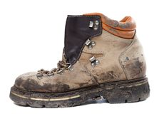 Old trekking boot in mud. Side view. Stock Image