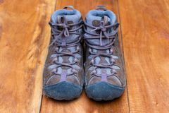 Old trekking shoes for walk to mountain. Shoes royalty free stock photo