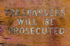 Old Trespassers sign Stock Photo