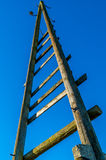 Old triangle electricity wooden pole with blue sky Royalty Free Stock Photos