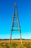Old triangle electricity wooden pole with blue sky Stock Photo