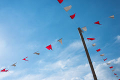 Old triangle flags hung across the  blue sky. Royalty Free Stock Images