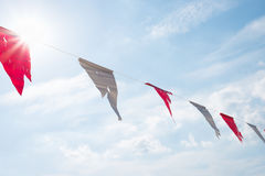 Old triangle flags hung across the  blue sky. Royalty Free Stock Photo