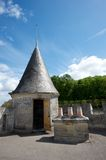 Old triangle roof. Triangular roof against blue skies at France chateau Stock Photos