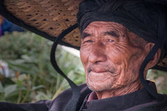 An old tribal chief in Torch Festival Stock Images