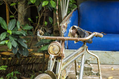 Old tricycle bicycle taxi parking. Stock Photo