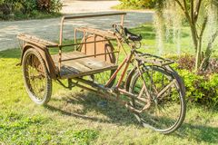 Old tricycle Parked on the lawn royalty free stock images