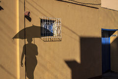 Old Trinidat.Shadow of a man with umbrella Stock Images