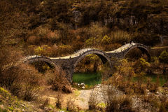 Old triple bridge. Of kalogeriko in eripus Greece Stock Images