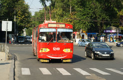 Red old trolley bus in Chisinau. Old colored and funny Trolley-bus in center of city Chisinau, moldavia Stock Image