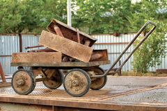 Old trolley with scrap metal. Stock Photos