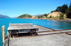 Old trolley on timber pier Royalty Free Stock Images