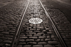 Old trolley tracks and cobblestones Royalty Free Stock Images