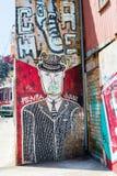 Old trolleybus and street art Valparaiso Royalty Free Stock Photos