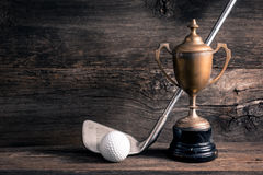 Old trophy with golf club. Still life photography : old trophy with golf club and ball on old wood Stock Photos